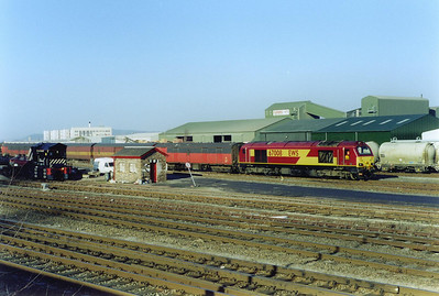 67008 has coupled onto the vans again and shunts them in Milburn Yard.