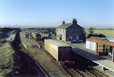 The short train consisting of just one Safeway refridgerated box passes through the station that forms the northern most junction in the UK as it carries out the shunting maneouvre to position the box to be unloaded.