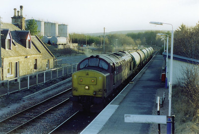 Lairg station is the location for more freight action on the Far North Line, sadly now (2006) the ONLY freight action. The type 3 runs in with 6H61 1410 TO Inverness to Lairg loaded fuel tanks.