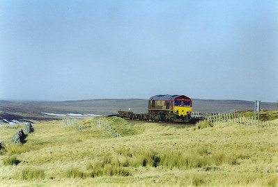 Deep in the Caithness Flow Country 66103 comes round one of the numerous bends near Kinbrace as the line follows closely the contours of the land.
