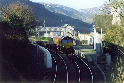 A spirited drive from Kinbrace to Helmsdale saw me catch up with 4D66 just before the coastal town and I managed to secure this shot of 66103 passing through the station at Helmsdale.