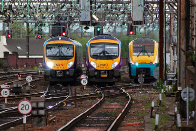 Three units of two classes line up with 185148 running in with 1B79 1228 Cleethorpes to Manchester Airport with 185122 also heading for the airport with 1P39 from Newcastle. On the right is 175116 in the turnback siding.