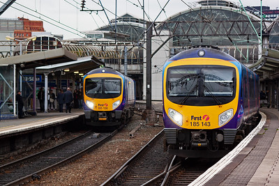 Sister Desiro units 185136 and 185143 pass at Piccadilly station with 185136 making its station stop en-route to the nearby airport. It is 1U65 1245 Blackpool to Manchester Airport. A few minutes later 185143 will head away for the same destination.