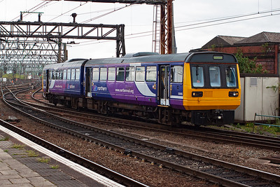 Class 142 Pacer 142014 approaches from the south with an unknown working.