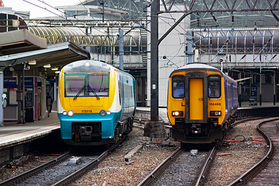 Side by side units, 175116 slows for its terminating stop with 1H88 1244 off Llandudno whilst just getting away is 156488 with 2H96 1452 to Buxton.