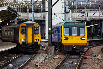 Sprinter 156466 runs in to stop with a Preston to Hazel Grove class 2 working, 2H06 1323 off. On the right is Pacer 142038 which will bounce its way to Chester as 2D46 1417 off Piccadilly.
