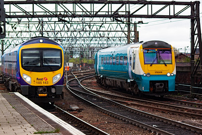 As 185143 runs in to make its station stop before reversing out to the airport, Arriva Coradia unit 175009 comes out of the stabling siding to stop at platform 14b to form 1D38 1350 Manchester Piccadilly to Llandudno.