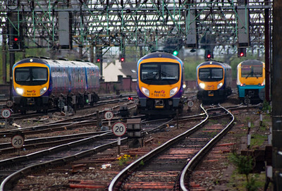 A busy scene in the station throat at Piccadilly with, L-R 185129 on 1B80 1355 Manchester Airport to Cleethorpes, 185142 1E81 1322 Liverpool Lime Street to Scarborough and 185146 forming 1S66 1400 Manchester Airport to Edinburgh. On the far right in the turnback siding is Coradia set 175007.
