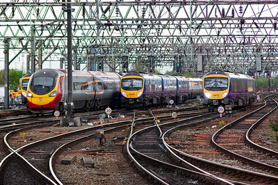 Another busy scene in the station throat. Pendolino 390048 approaches slowly from London with 1H26 1300 off Euston. 185104 runs in with 1P42 1435 from Manchester Airport to Middlesborough. The second Desiro unit is 185148 rostered to 1B79 1228 Cleethorpes to Manchester Airport.