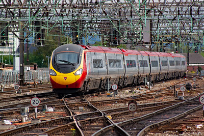 I had only been on Piccadilly's platforms for some 15-20 minutes having travelled from Euston, now another Euston to Manchester working arrives with 390050 rostered to 1H26 1300 off London.