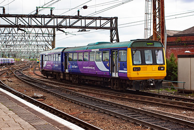 Pacer unit 142003 approaches from the east towards the through lines with a class 2 working, 2F87 1503 off Manchester Airport to Southport.