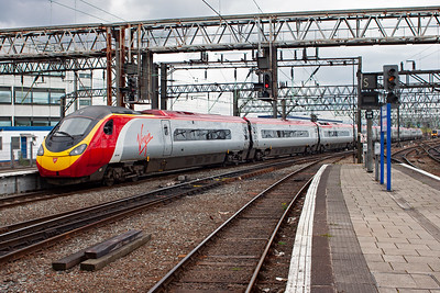 Pendolino 390049 departs Piccadilly for London Euston at 1515 as 1A47.  The electric unit was very quiet with the wheels making all the noise.
