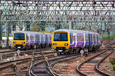 A pair of Northern Trains class 323 EMUs glide away from Piccadilly on their respective class 2 workings. 323225 on the left heads to Hadfield as 2H74 1448 off. At the same time 3213226 works 2K18 to Stoke on Trent.
