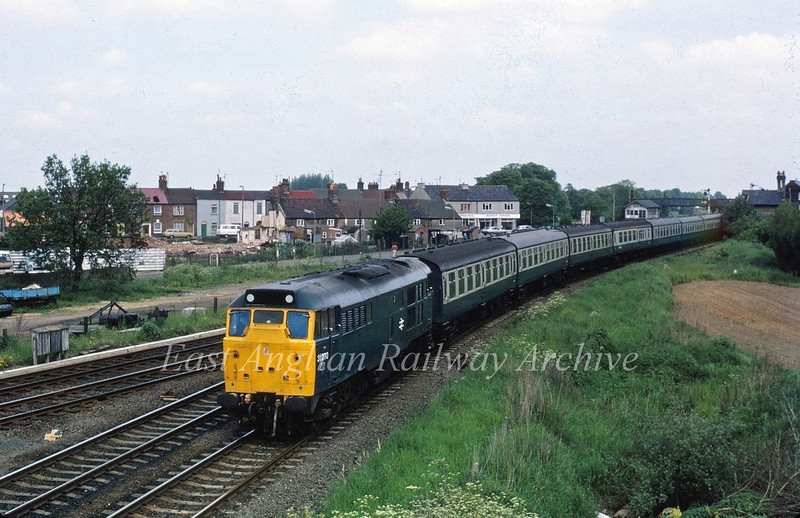 31270 takes the March curve out of Spalding with a summer Saturdays only working to Yarmouth on 31st May 1981.
