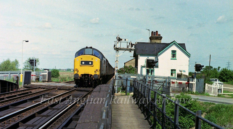 37121 is signalled off the main line at Twenty Feet River with a mixed fitted freight. 19th May 1979.