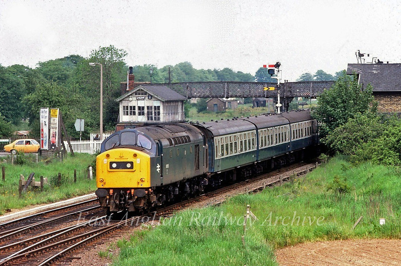 40168 about to take the March curve out of Spalding with a Newcastle to Yarmouth working.  16th August 1980