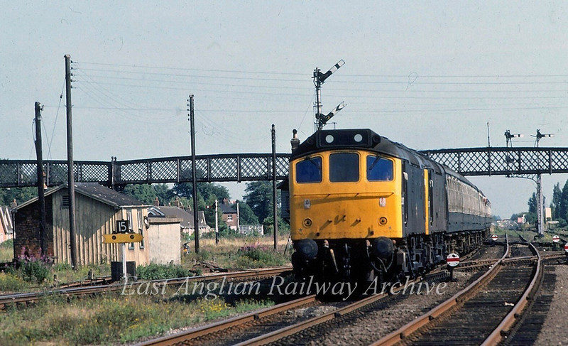 The 0832 Derby to Yarmouth passes Spalding behind 25127 and 25137.  16th August 1980