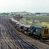 08889 shunts ballast wagons at March Whitemoor Junction. The Wisbech branch is the single track line straight ahead. 28th July 1979