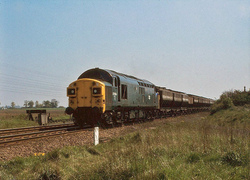 37054 approaching Murrow with a Middleton Towers sand working. 10th May 1980.