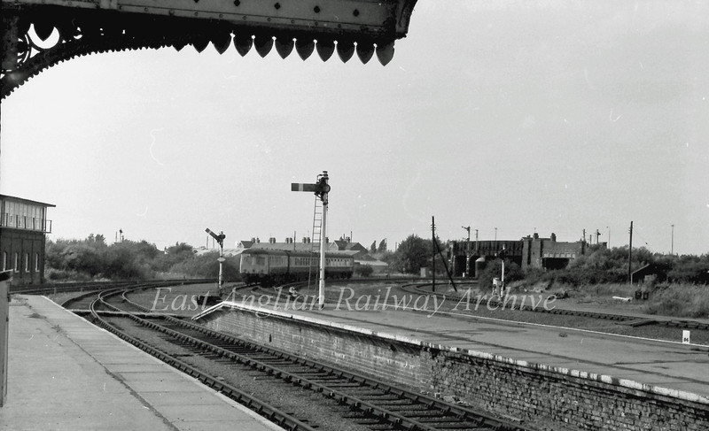 A Swindon cross country unit was recorded leaving March on a Cambridge to Doncaster working and is about to pass under Norwood Road bridge. C 1977.