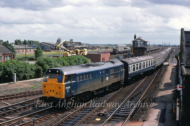 Under cloudy skies 31325 takes the Great Northern and Great Eastern Joint line at March East Junction with the 0920 Yarmouth to Newcastle Summer Saturdays only working.  1st August 1981