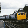 25270/25056 stand at the now abandoned platform 1 at March with the 0835 Derby to Yarmouth.  ist August 1981.