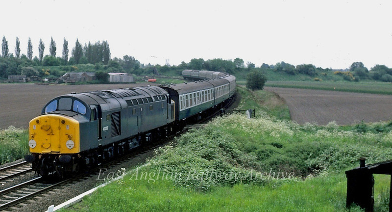 Unknown Class 40 approaches Spalding from March.  16th August 1980