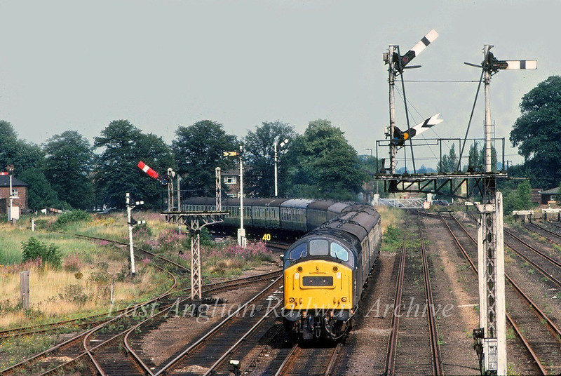 40146 approaches Spalding amongst a fine array of semaphores on a Newcastle to Yarmouth summer Saturdays only working.  16th August 1980.  The original line to Boston was straight ahead.