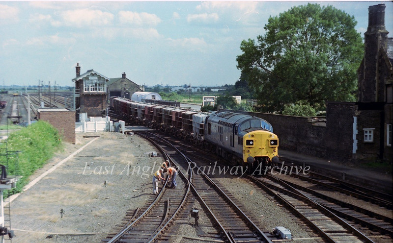 37084 heads onto the Spalding line at March East Junction with cement wagons. 17th August 1978.