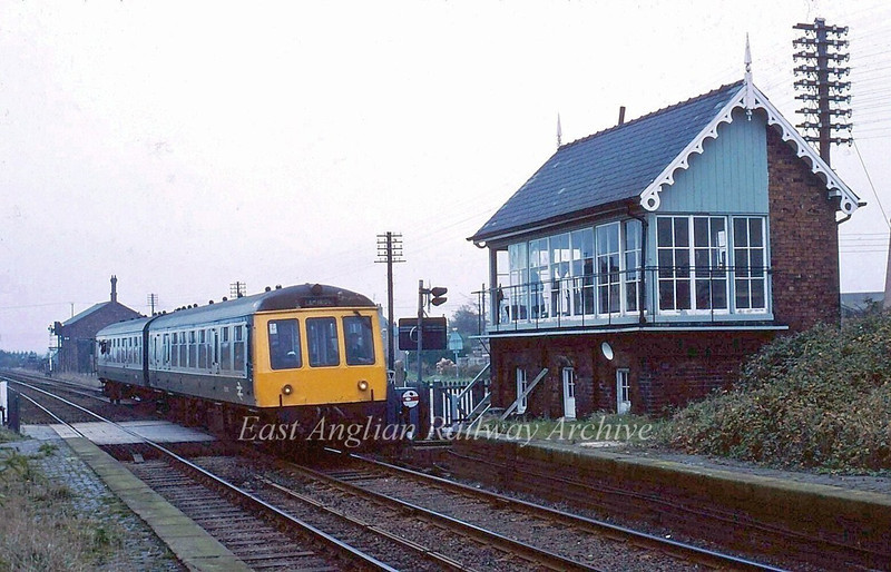 Two months before closure a Doncaster to Cambridge dmu passes Cowbit Box.  September 1982