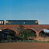 47072 crosses Rings End viaduct at Guyhirn with empty coaching stock from the Spalding Flower Festival.  Oxford to Spalding. 10th May 1980