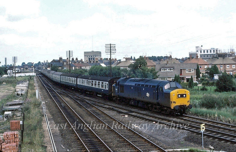 37174 takes the March curve out of Spalding on a Manchester to Yarmouth working.  16th August 1980