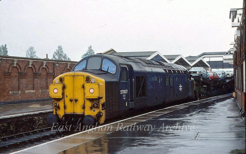 37007 passes March on a wet 8th July 1980 with the 1425 Parkeston to Bathgate cartics.