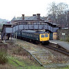 Stour Valley Line station at Sudbury on 15th February 1980. The station has now been demolished and the site occupied by the Kingfisher Leisure Centre. The 1334 to Colchester stands at the one remaining platform.Leading car is E56116  with E51256 at the rear.