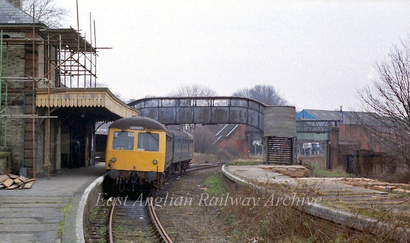Dereliction at Sudbury and soon the station will be a distant memory. No trace remains today, the site is occupied by the Kingfisher Leisure centre. The 1334 to Colchester stands at the platform.  15th February 1980