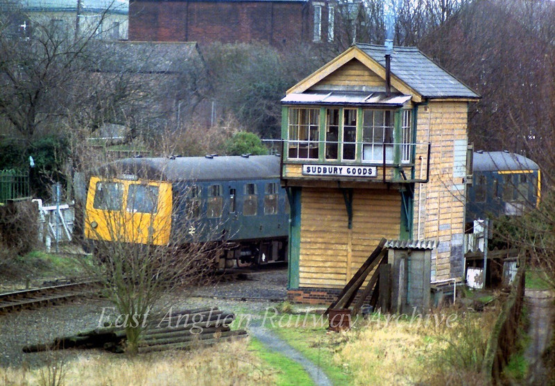 The 1210 from Colchester passes the Sudbury Goods Signal Box on 15th February 1980. The box has since been demolished.