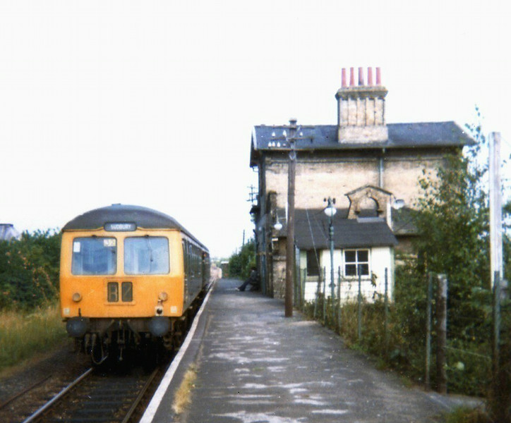 1054 Colchester to Sudbury stands at Bures on 31st July 1973. The station house has since been demolished.