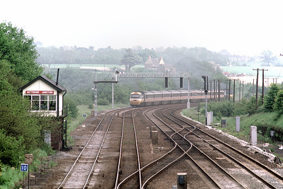 An HST heads away from Kettering Junction in June 1986 - New signalling Gantries are already in place
