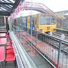 A Metro train passes through Monkwearmouth station on its way to Sunderland