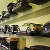 Display of cars mounted on museum wall