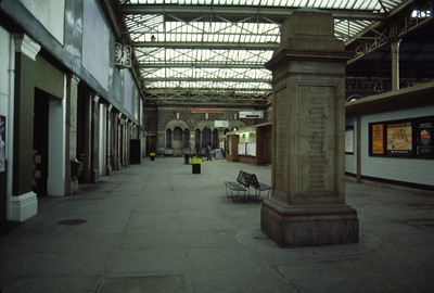 Broad Street station concourse on a quiet Saturday.   By this time the ticket offices were in the more modern structures plonked onto the platforms.   What happened to the War memorial when the station was demolished?