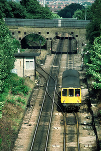 Class 104 DMU Barking Gospel Oak service passing  Harringay Park Jct 25/8/85