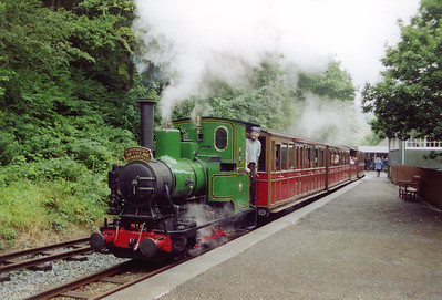 With much fuss and with steam hanging in the damp air, No 6 gets away from Abergynolwyn for the 3/4 mile run to Nant Gwernol.  The steepest gradient on this section is 1 in 127.