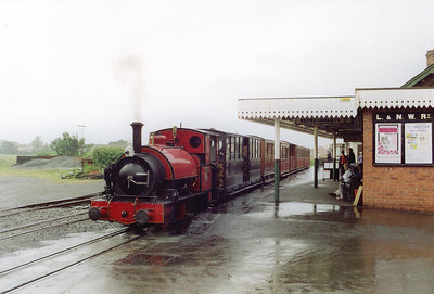 """A different day, a different railway, the same rain!!  This is where it all started, Railway Preservation was born here.  This is Tywyn on the Talyllyn Railway, the very first railway to be operated entirely by volunteers.  In the rain is No 3 """"Sir Haydn"""" ready to work the 1010 from Tywyn to Nant Gwernol.  The 0-4-2T loco was built in 1878 by Hughes' Loco and Tramway Engine Works of Loughborough for the nearby Corris Railway.  Both lines share the unusual gauge of 2'3"""".   3/8/2000"""