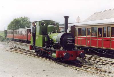 Ross and I returned to Tywyn behind No 6and at Tywyn Wharf we crossed onto the other side of the station yard to get the train on the sunward side.  No 2 has topped up with coal and water and will move onto the head of the train brought in by No 6 ready to go back to Nant Gwernol.