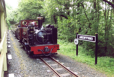 There are no intermediate stations on the line but ther ear etwo passing loops and a mod point water tank.  Aberffrwd passing loop is about a third of the way down form Devil's Bridge and here No 9 passes by the name board.  The round plate says the line is 253 feet above sea level at this point.