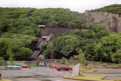 At the end of the day, Thomas Back shunts its stock into the carriage shed.  Behind the train is a restored incline plane up the hillside.  Visible to the right is Vivian Quarry, part of the massive Dinorwic Quarry system.
