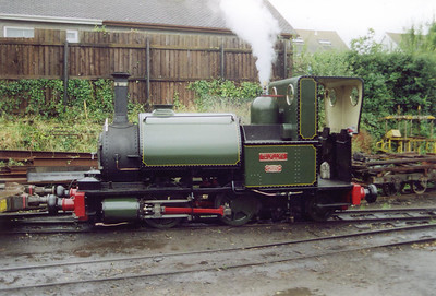 """Out on the road and the train passes the loco shed at Pendre, outside the shed and in steam is No 1 """"Talyllyn"""" also built in 1866 by Fletcher Jennings.  This loco and the train engine No 2 were the two original locos built for the opening of the railway."""