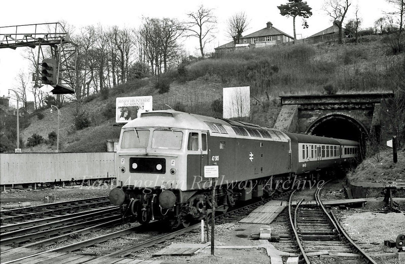 47555 emerges from Stoke Tunnel, Ipswich with a Liverpool Street to Norwich working in November 1980.