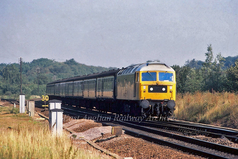 47003 passes Haughley Junction with the 0900 Yarmouth to Liverpool Street.  1st September 1980